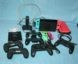 Nintendo Switch Video Game Console With Joy Con And Pro Controllers 20 Piece Set - $519.74