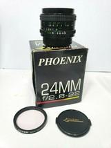 Phoenix 24 mm f/2.8-f/22 macro lens with tiffen skylight filter. - $74.14