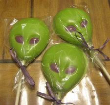 One dozen alien head chocolate lollipops image 3