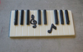 Solid chocolate piano keys keyboard with music note centerpiece cake topper - $10.50