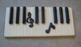Solid chocolate piano keys keyboard with music note centerpiece cake topper image 4