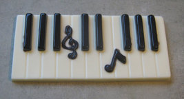 Solid chocolate piano keys keyboard with music note centerpiece cake topper image 5