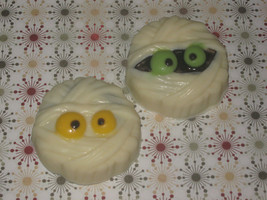 One dozen mummy design chocolate covered sandwich cookies - $18.00