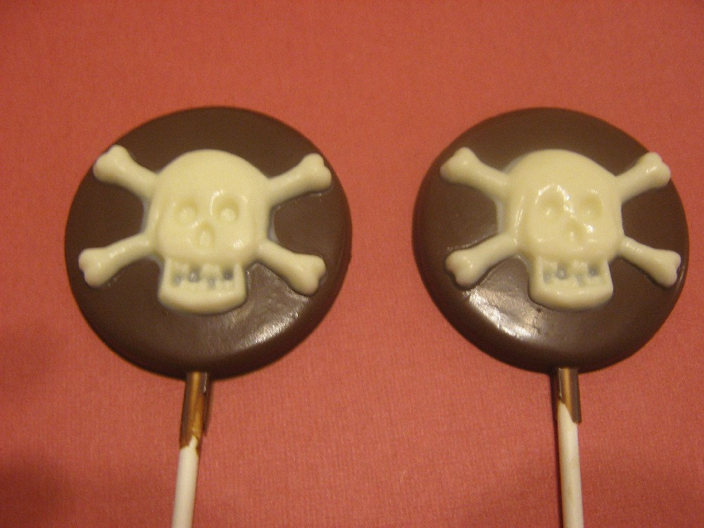 Primary image for One dozen round lollipop sucker with skull and crossbones pirate party favors
