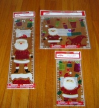 Holiday Time 3 Packs of Santa and Presents Style Gel Clings  - $8.00