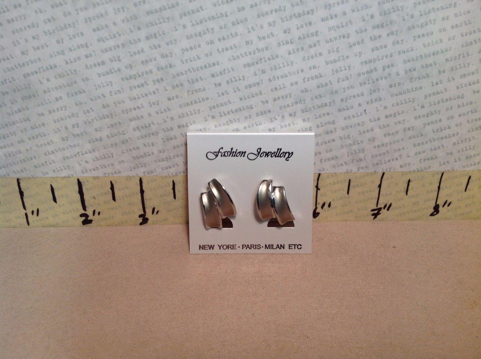 Cute Simple Clamp Back Silver Tone Earrings