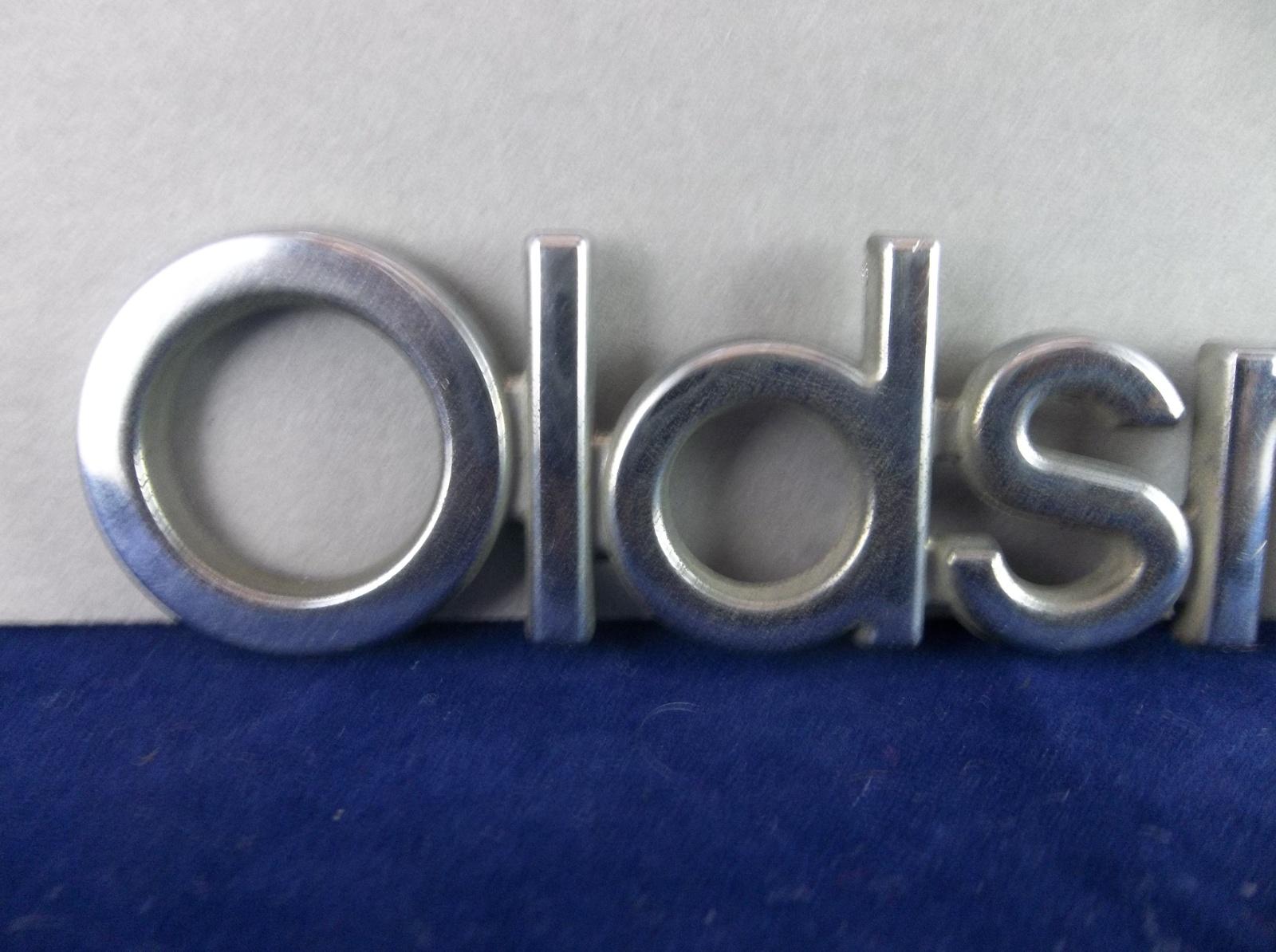1984-1996 Oldsmobile Cutlass Ciera 88 98 Chrome Plastic Script Emblem OEM