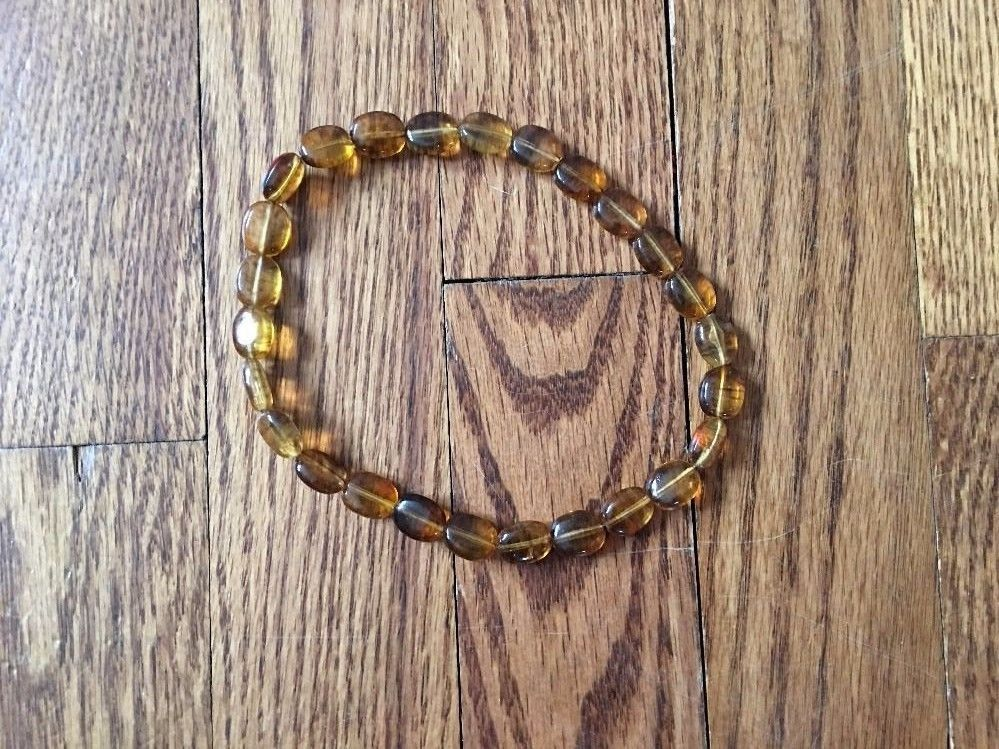 Amber Colored Plastic Beads Stretch Necklace