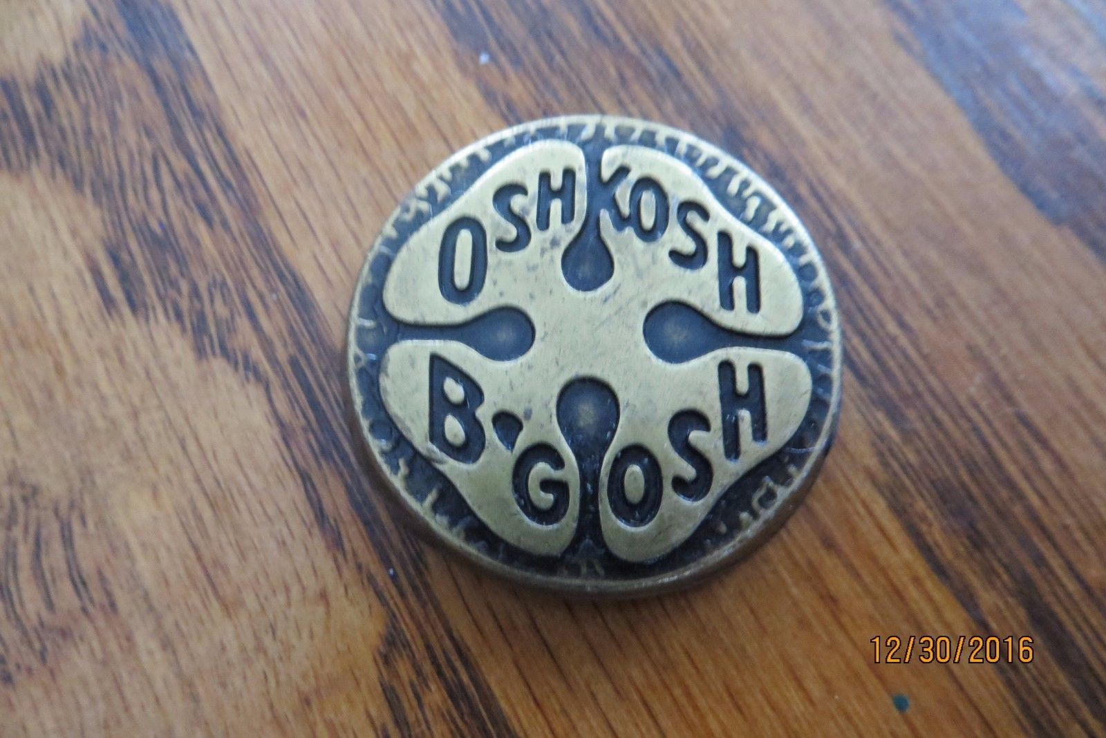 Oshkosh B'gosh solid brass trivit paperweight advertising company logo obsolete