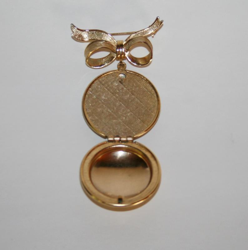 Vintage Avon Gold Toned Perfume Locket Bow Brooch  J204GS