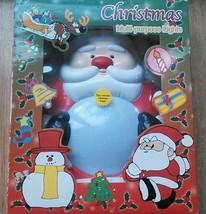 CHRISTMAS Lighted SANTA MUSICAL Figure Wall Lig... - $19.54