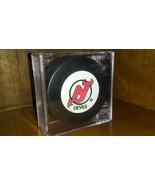 New Jersey Devils Hockey Puck In Case - $9.85