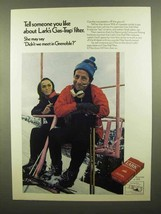 1970 Lark Cigarettes Ad - Didn't We Meet in Grenoble? - $14.99