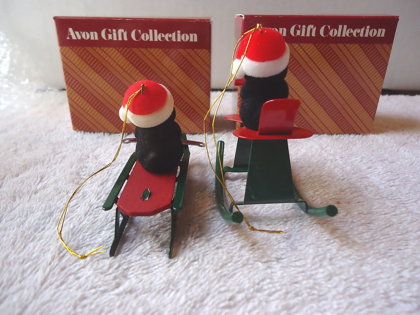 """Vintage """" NOS """" ? Set Of 2 Avon Gift Collections,Jolly Penguin Ornaments,Sled &"""