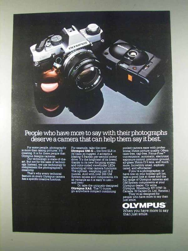 Primary image for 1982 Olympus OM-G and XA2 Cameras Ad - More to Say