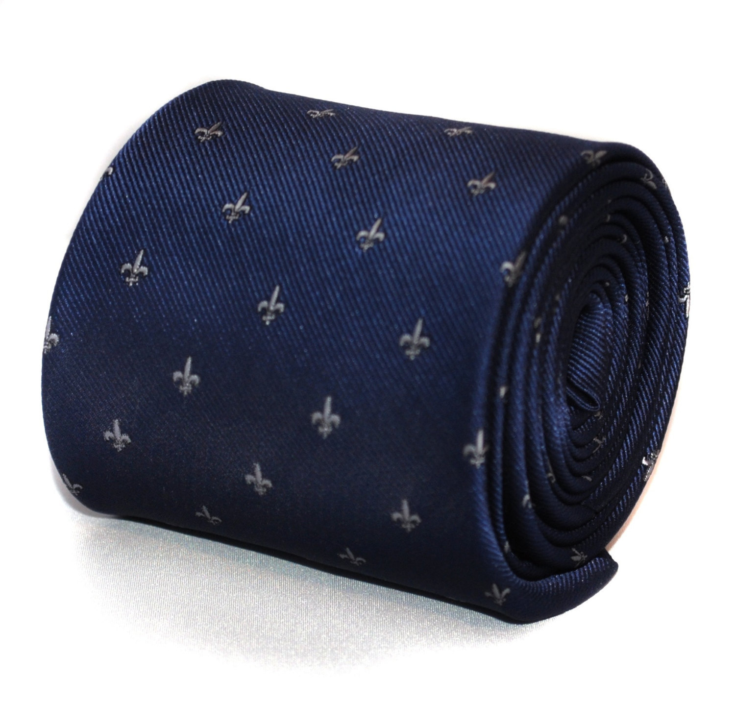 navy blue tie with fleur de lis (lys) design with signature floral design to rea