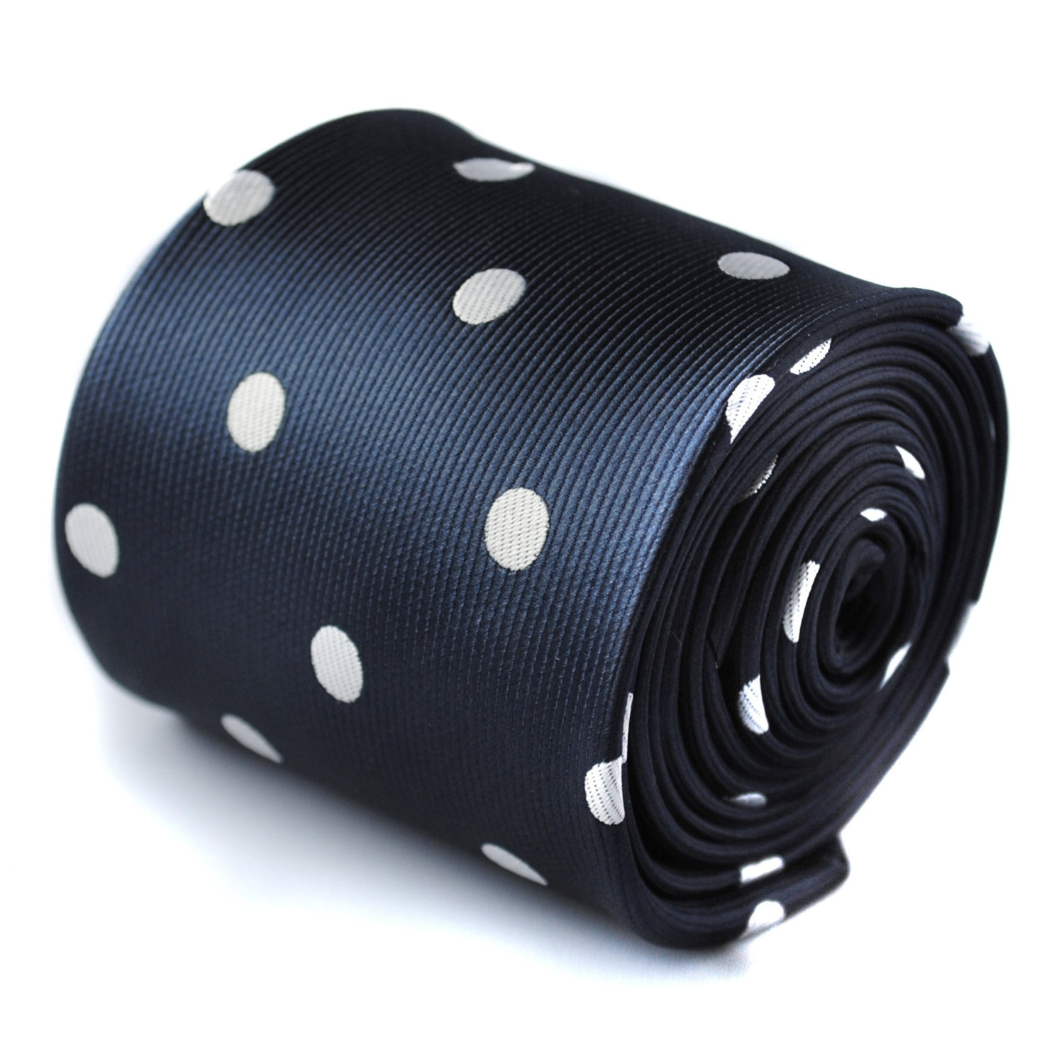 navy blue tie with white spots with signature floral design to the rear by Frede