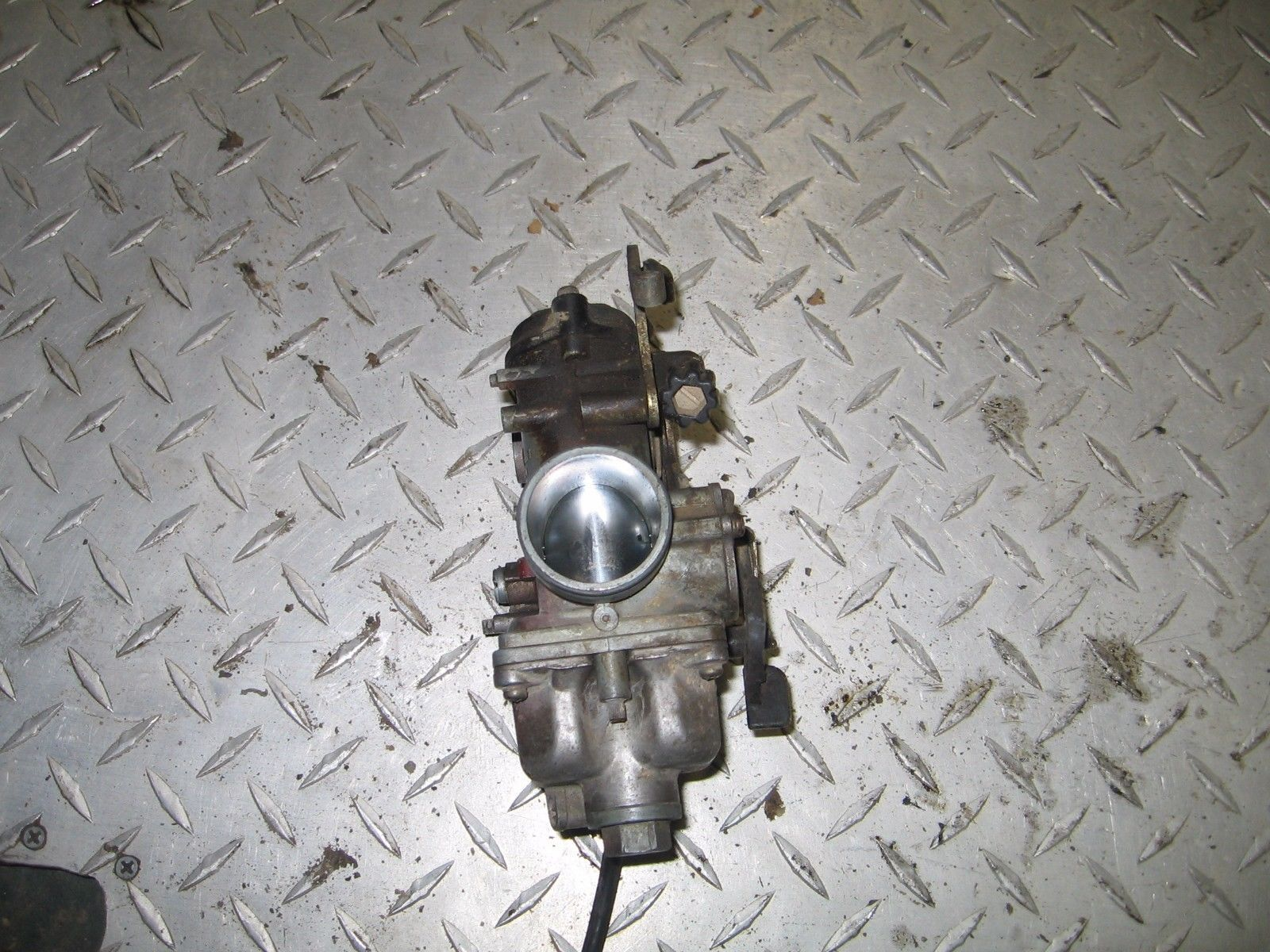 KAWASAKI 2002 LAKOTA 300 2X4  CARBURETOR (STRICTLY FOR PARTS)   PART 28,375