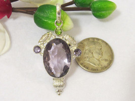 Beautiful jewelry Silvertone Quartz Amethyst & Peridot pendant - $17.00