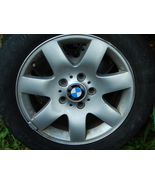 1 Blizzak Bridgestone Tire 215/R6016 and 4 BMW Aluminum Rims - $100.00