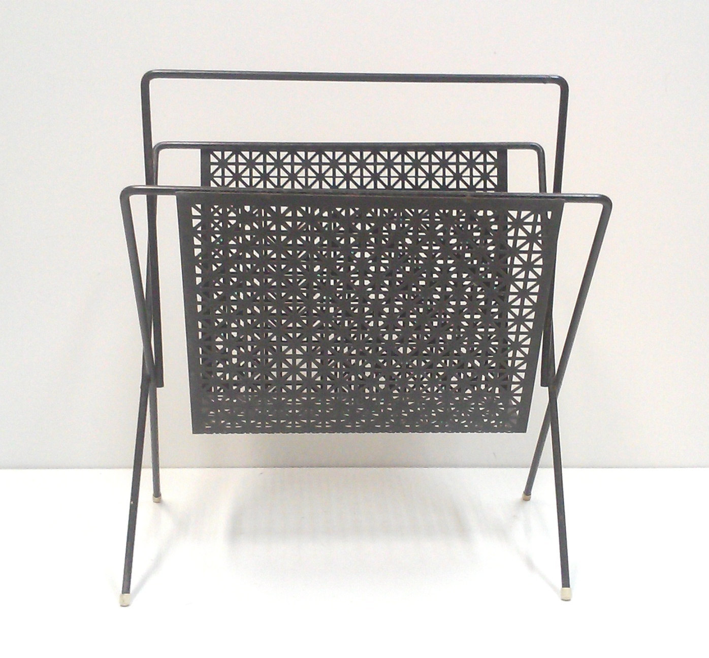 Mid-Century Perforated Metal Magazine Rack in the Style of Mategot