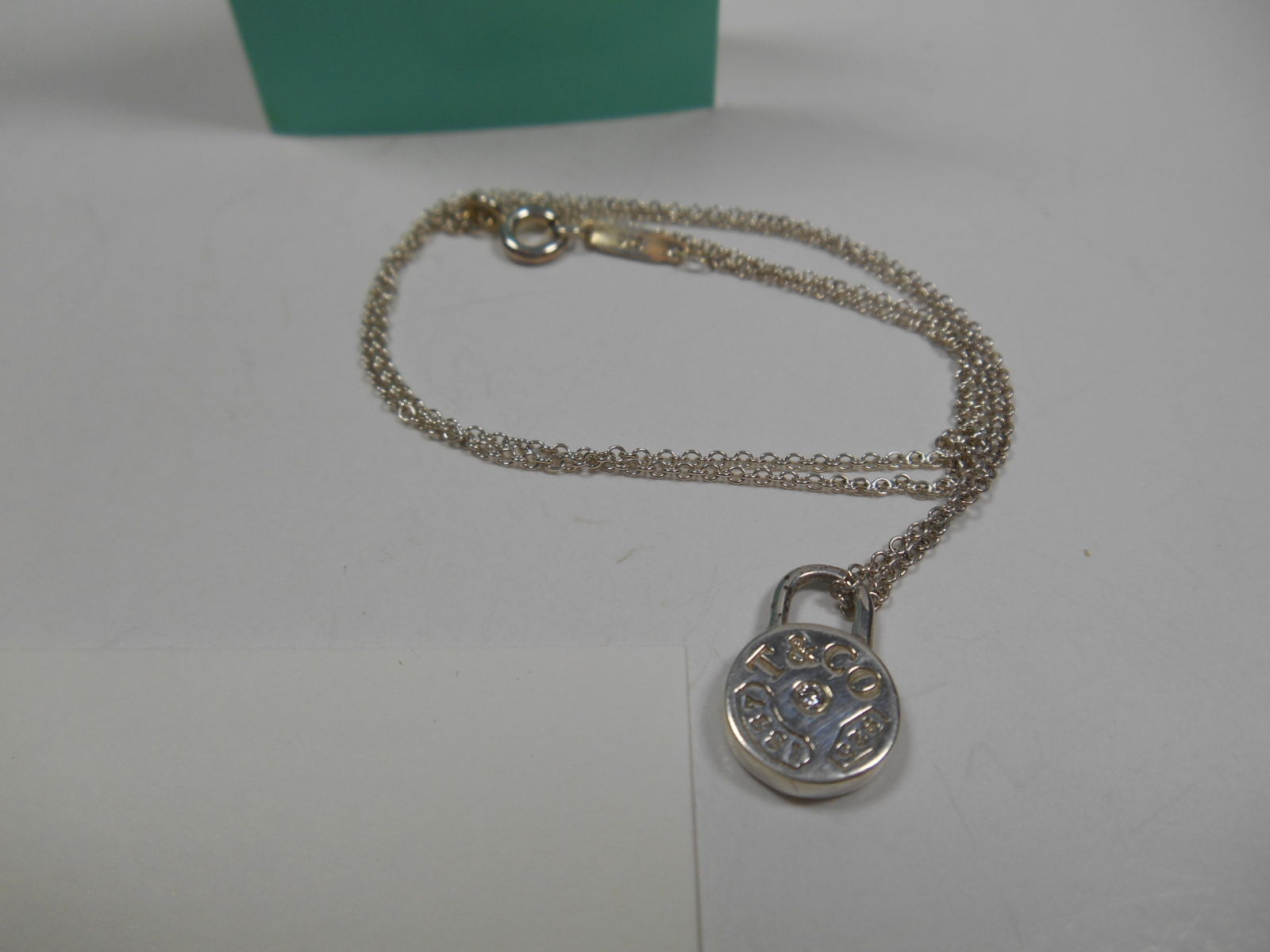 Primary image for Tiffany & Co. 1837 Diamond Round Padlock Necklace Charm Pendant $875 Sterling