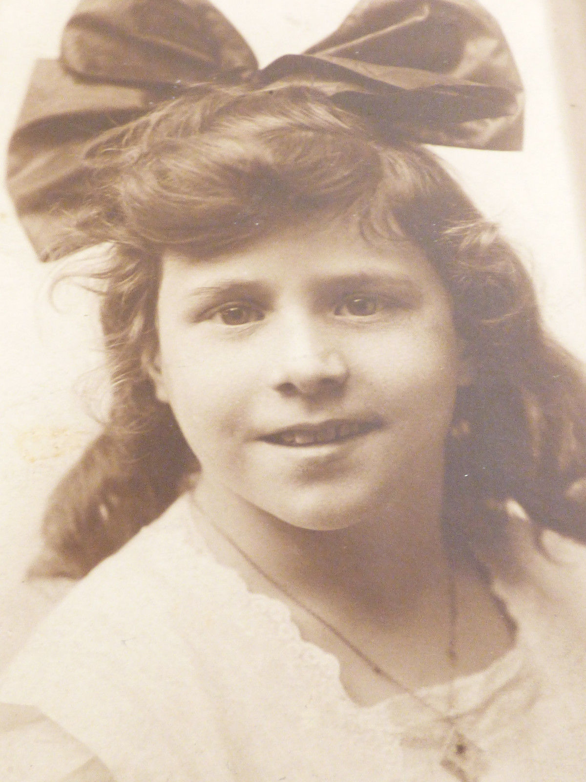 Primary image for Vintage antique Photograph photo Sweet face Girl Long Hair large Bow 9.75 x 4.25