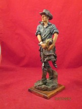 COWBOY CARRYING SADDLE , resin figurine from Elegante Collection - $22.00