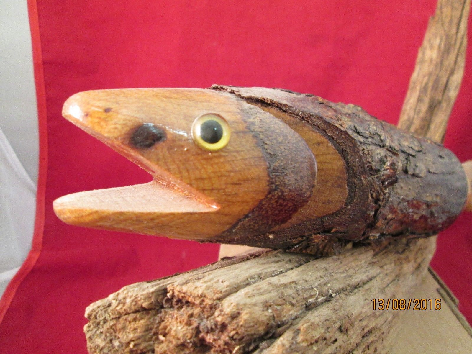 Carved wood fish on driftwood folk art indigenous