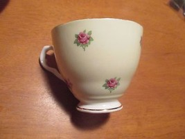 Unknown Fine Bone China Tea Cup Pastel Yellow Exterior with Small Pink R... - $1.49