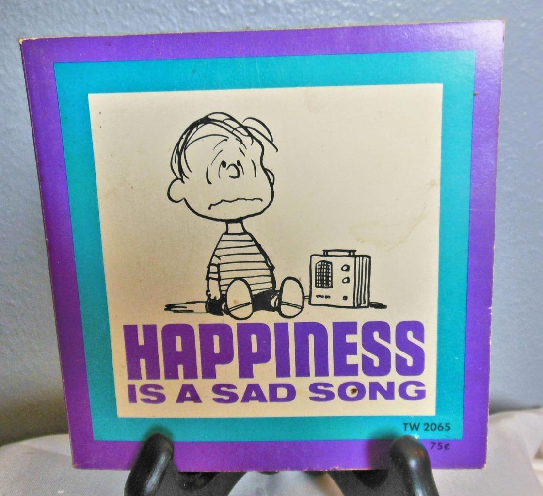 "Vintage Peanuts Soft Cover Book :Happiness is a Sad Song"" 1971"