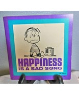 """Vintage Peanuts Soft Cover Book :Happiness is a Sad Song"""" 1971 - $19.40"""