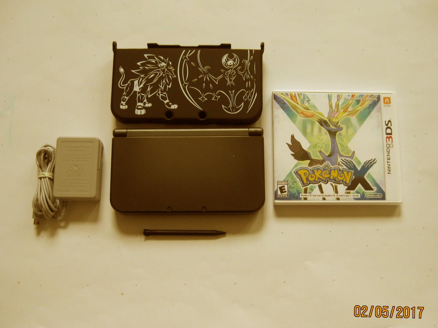 Primary image for Nintendo New 3DS XL Black w Pokemon X & More !!