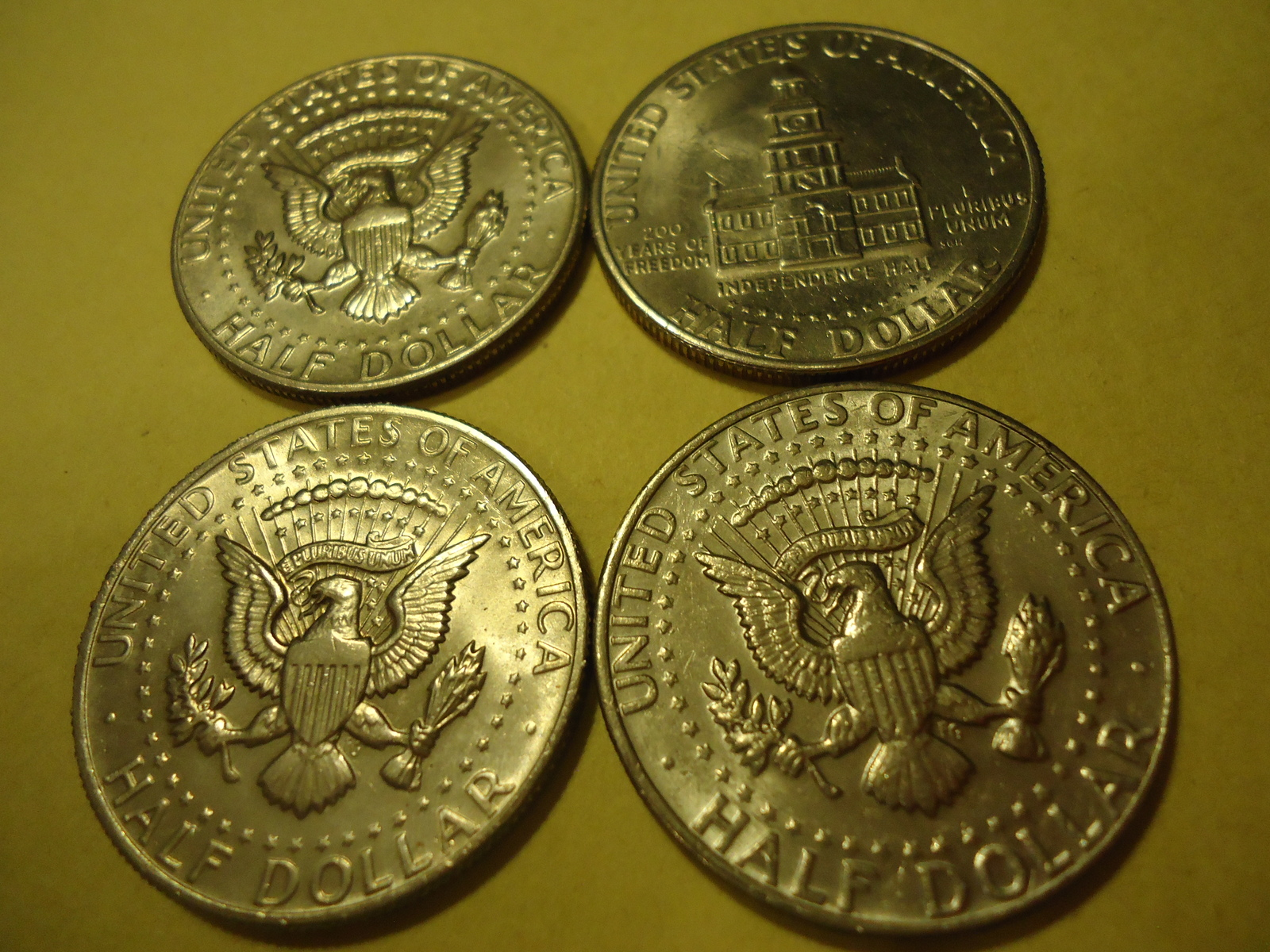 Primary image for LOT OF 4 KENNEDY HALF DOLLARS (DIFFERENT DATES ONE IS 1983)  COMBINED SHIPPING 7