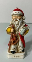 1885 Santa Claus Christmas Tree Ornament Figurine with Rocking Horse - $11.71