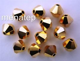 5 6 mm Swarovski Crystal Bicones - Aurum 2x(Please read item description) - $2.59