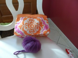 Orange and purple cosmetic bag from Clinique plus a purple scrub buff - $5.00