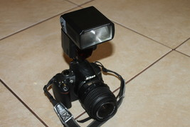 Nikon D3000 10.2MP Digital SLR Camera with lens and sigma ef-500 flash only 2/19 - $189.00