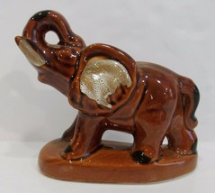 brown ceramic elephant figurine - $12.00