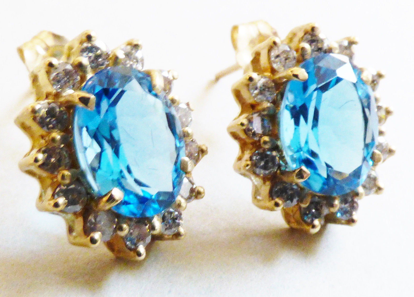 14kt Yellow Gold .78 CTTW Oval Blue Topaz & Round Diamonds Stud Earrings