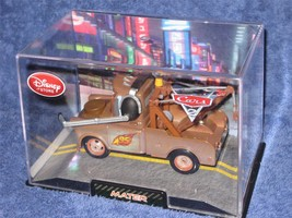 DISNEY STORE MATER (PIXAR CARS 2)  BRAND NEW in Collector Case - $17.30