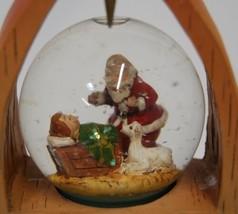 Roman Inc Peace Arch Snow Globe Kneeling Santa 8 Inches Tall image 2