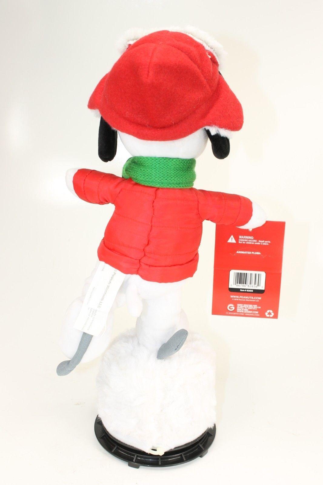5cb9d671da638 Gemmy Peanuts Snoopy Musical Skating Figure w Trapper Hat Christmas Decor -  NWT