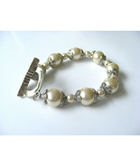 HANDMADE PEARL AND TIBETAN SILVER  BEADED  WITH HAMMERED TOGGLE CLASP BR... - $10.88