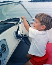 John F. Kennedy Jr. at the wheel of a speedboat August 1963 New 8x10 Photo - $6.16