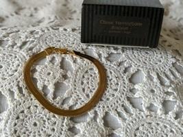 Avon Designer Signed Classic Herringbone Bracelet - $7.75
