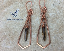 Handmade copper earrings: framed wire wrapped dangling amber glass dagge... - $28.00