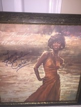 FRAMED AND SIGNED PICTURE OF NATALIE COLE                           3686 - $48.37