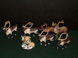 "DRESS UP YOUR VILLAGE WITH 7 REINDEER FIGURES- AVERAGE HEIGHT 31/2"" TO 4"" - $11.88"