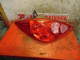 12 11 10 09 08 07 Nissan Versa hatchback oem left brake tail light assembly - $24.74